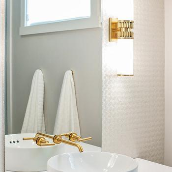 Madison Taylor Design - bathrooms - ceiling height mirror, frameless mirror, ceiling height bath mirror, ceiling height vanity mirror, vanity mirror, frameless mirror, frameless vanity mirror, aged brass sconces, bowl sink, round sink, round bowl sink, wall mount faucet, wall mounted faucet, kohler faucets, gold faucet, gold bathroom faucet, brushed gold faucet, gold wall mount faucet, gold wall mounted faucet, brown washstand, white quartz countertop, champagne wallpaper, textured wallpaper, champagne textured wallpaper, vessel sink, vox sink, kohler sink, vessel sink, kohler vessel sink, Kohler Vox Round Vessel Round Above Counter Sink, Kohler Purist Widespread Wall Mount Bathroom Sink Faucet, Hudson Valley Lighting Harper Sconce,