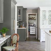 House Beautiful - kitchens: revere pewter, gray cabinets, gray kitchen cabinets, dark gray cabinets, dark gray kitchen cabinets, brass pulls, brass hardware, brass cabinet pulls, wood herringbone floor, herringbone floor, kitchen desk, built in desk, bistro chair, french bistro chair, 2 tone kitchen,