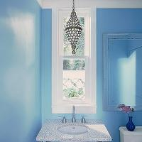 House Beautiful - bathrooms - mirror over toilet, mirror above toilet, blue powder room, powder room, beaded light pendant, 2 leg washstand,