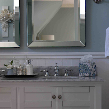 Georgica Pond Interiors - bathrooms - blue walls, blue wall color, beadboard walls, beadboard, bathroom beadboard, beadboard half wall, white bathroom beadboard, nickel hardware, marble countertops, marble counters, dual vanity, white vanity, white sink vanity, white bathroom vanity, beveled mirror, beveled glass mirror, mirror framed mirror, beveled mirror, botanical tissue box holder, silver tray, white soap dispenser, hammered metal canister, blue and white bathroom, polished nickel wall sconce, blue and white floral shade, blue and white botanical shade, white and blue tissue box holder, white and blue bathroom, carrera marble, carrera marble countertops, double vanity, white double vanity,