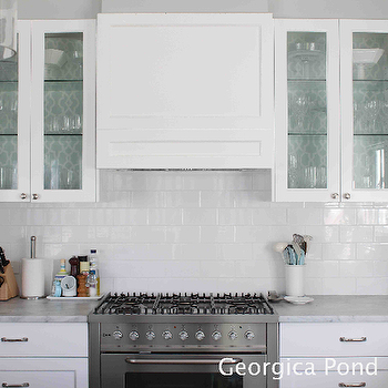 Georgica Pond Interiors - kitchens - white cabinets, white cabinetry, white kitchen cabinets, white kitchen cabinetry, glass front cabinets, glass fronted cabinetry, marble counters, marble countertops, gray and white marble counters, gray and white marble countertops, polished nickel hardware, stainless steel oven, stainless steel stove, stainless steel range, subway tile, subway tiled backsplash, white subway tile, white subway tile backsplash, glass shelves, aqua blue and white lattice wallpaper, blue and white lattice wallpaper, aqua blue and white fretwork wallpaper, blue and white fretwork wallpaper, wallpaper backed kitchen cabinets, wallpaper backed glass front cabinets, wallpaper backed glass fronted cabinets, wallpaper lined glass front cabinets, wallpaper lined kitchen cabinets, wallpaper backing, wallpaper cabinets, wallpapered cabinets, wallpaper on back of cabinet, glass front kitchen cabinets, trellis wallpaper, blue trellis wallpaper, wallpapered lined cabinets, wallpapered lined kitchen cabinets, wallpaper backed cabinets, Summer Palace Fret Wallpaper,