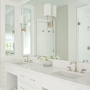 Laura Tutun Interiors - bathrooms - his and her sinks, built in vanity, built in washstand, built in double vanity, built in double washstand, lucite pulls, lucite hardware, modern faucets, inset mirror, sconces on mirror, monochromatic bathroom, white bathroom, white double vanity, white double washstand,