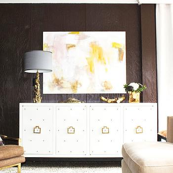 Laura Tutun Interiors - living rooms - paneled living room, wood paneled living room, living room wall panels, living room paneling, yellow art, yellow abstract art, studded cabinet, white studded cabinet, studded buffet, white studded buffet, studded credenza, white studded credenza, gold ring pulls, gold table lamp, tree branch lamp, gold branch lamp, gray lamp shade, , Worlds Away Studly White Lacquer Studded Console Buffet Table,