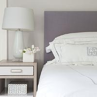Laura Tutun Interiors - bedrooms - purple headboard, purple upholstered headboard, purple and gray bedroom, monogrammed bedding, monogrammed duvet, monogrammed shams, white and purple bedding, white and purple duvet, white and purple shams, 2 tone nightstand, white glass lamp, mosaic tiled box,