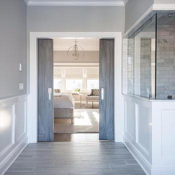 Cory Connor Design - bathrooms - Gray barn doors, interior barn doors, subway tile, gray tile, wood like tile, sliding barn doors, pocket barn doors, bathroom pocket doors, bathroom barn doors, san antonio gray, wainscoting, bathroom wainscoting, gray floor tiles,