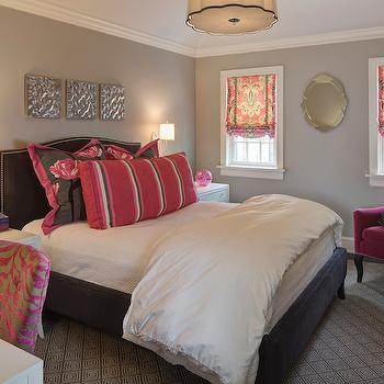 W Design - bedrooms - pink and gray bedroom, gray walls, gray wall color, white nightstand, white bedside table, hardwood floors, gray and white geometric rug, gray and white greek key rug, greek key rug, white bedding, white bed linens, white sheets, white duvet, pink and gray floral pillow, pink and gray floral sham, pink gray and white striped pillow, nickel wall sconce, pink armchair, fuchsia pink armchair, venetian mirror, oval venetian mirror, pink and gray ikat roman shade, pink and gray ikat window shade, scalloped pendant, scalloped drum pendant, white desk, pink and gray zebra print chair, zebra print chair, silver abstract art, art over headboard, dark gray headboard, charcoal gray headboard, gray headboard, gray headboard with nailhead trim, dark gray headboard with nailhead trim, fuchsia velvet chair, zebra chair, pink and gray zebra chair, pink and gray chair, pink and gray shams, modern floral shams, charcoal gray headboard, charcoal gray velvet headboard, charcoal gray bed, charcoal gray velvet bed, camelback headboard, velvet camelback headboard, gray velvet camelback headboard, damask roman shades, pink and gray roman shades, Robert Abbey Axis Drum Pendant,