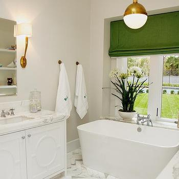 Evars and Anderson - bathrooms - master bathroom, burnished brass sconce, antique burnished brass sconce, beveled mirror, frameless beveled mirror, his and her vanity, his and her bath vanity, his and her bathroom vanity, his and her washstand, overlay doors, overlay cabinet doors, contemporary washstands, white and grey marble, white and grey marble counters, marble herringbone tiles, herringbone floor, marble herringbone floor, freestanding tub, freestanding bathtub, green roman shade, bathtub chandelier, chandelier over bathtub, pendant over bathtub, lighting over bathtub, bathroom shelves, bathroom shelving, amazing bathroom, Ruhlmann Single Sconce, Hicks Pendant,