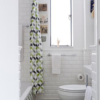 Lauren Rubin Architecture - bathrooms - geometric floor tile, geometric bathroom tile, interlocking circle floor tile, interlocking circle shower curtain, geometric shower curtain, gray green and white geometric shower curtain, tub shower combo, bath shower combo, tiled tub surround, tiled bath surround, towel rail, towel bar, polished nickel towel rail, toilet, white walls, retro shower curtain, tiled wainscoting, beveled subway tile, tiled half wall, beveled white subway tile, beveled subway shower surround, white towel, white and green tiles, white and green floor tiles, green and gray shower curtains, geometric shower curtain, kohler toilet, beveled subway tile shower, bathroom subway tiles,