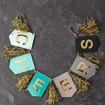 Art/Wall Decor - Cheers Banner I anthropologie.com - cheers banner, cheers banner with gold tassels, cheers wall decor,