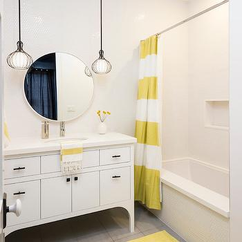Von Fitz Design - bathrooms - white and yellow bathroom, white and yellow shower curtain, stripe shower curtain, striped shower curtain, white and yellow stripe stripe curtain, drop in bathtub, black cage pendants, cage pendants, white washstand, oval sink, bathroom sinks, gray tiles, yellow bath mat, bath mat,