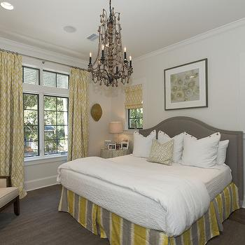 Rice Construction Group - bedrooms - yellow and gray bedroom, gray headboard, gray velvet headboard, camelback headboard, gray camelback headboard, yellow and gray bedskirt, yellow and gray bed skirt, lattice roman shade, white and yellow roman shade, lattice curtains, white and yellow curtains, white and yellow drapes, lattice drapes, white and yellow lattice curtains, black chandelier, bedroom chandeliers, chandelier over bed, single nightstand, single bedside table, skirted bedside table,