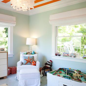 Art Haus - boy's rooms - stripe ceiling, orange stripe ceiling, striped ceiling, orange striped ceiling, nursery stripe ceiling, nursery striped ceiling, seafoam green walls, 2 tone changing table, slipcovered glider, slipcovered ottoman, train table, white roman shades, corner glider,