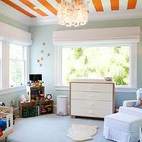 Adorable boy's nursery features orange striped ceiling over seafoam green walls ...