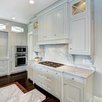 Jill Frey Kitchen Design - kitchens: gray walls, gray wall color, gray cabinets, gray cabinetry, gray kitchen cabinets, gray kitchen cabinetry, pale gray cabinets, pale gray kitchen cabinets, nickel hardware, seamless marble backsplash, solid marble backsplash, ceiling height cabinets, ceiling height cabinetry, crown molding, glass front cabinets, glass front cabinetry, stainless steel double oven, double oven, stainless steel cooktop, stainless steel stovetop, recessed lighting, pot lights, hardwood floors, hidden oven hood, concealed oven hood, hidden range hood, hidden kitchen hood, hidden hood, disguised range hood, disguised kitchen hood, cabinet fronted oven hood, carrera marble, carrera marble counters, carrera marble countertops, carrera marble backsplash, light gray cabinets, light gray kitchen cabinets, gray owl, gray owl cabinets, gray owl kitchen cabinets,
