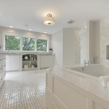 Divine Custom Homes - bathrooms: master bath, spa like bath, spa like bathroom, paneled bathtub, soaking tub, paneled soaking tub, soaking bathtub, bathtub niche, tiled niche, bathroom niche, white marble walls, white marble tiled wall, marble basketweave floor, built in vanity, his and her vanity, his and her washstand, gray marble, gray marble countertop,