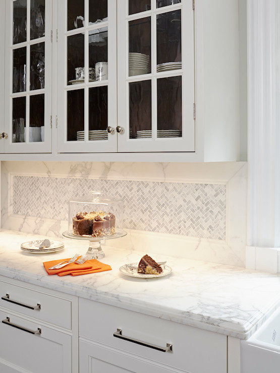White herringbone tile backsplash