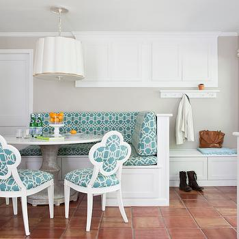 Roxanne Lumme Interiors - dining rooms - L shaped banquette, dining banquette, L shaped dining banquette, simple scallop pendant, round dining table, marble top dining table, round marble dining table, white marble top dining table, quatrefoil chairs, quatrefoil dining chairs, turquoise trellis fabric, turquoise trellis chair, turquoise trellis cushions, small mudroom, built in bench, mudroom bench, dining nook, breakfast nook, Barbara Barry Simple Scallop Pendant,