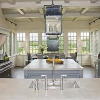 Beautiful kitchen with coffered ceiling accented with blue lanterns over blue ...