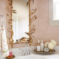 Alice Lane Home - bathrooms - gold and pink bathroom, gold and pink room, gold leaf mirror, leaf mirror, gold leaves mirror, gold leaf leaves mirror, chinoiserie mirror, white marble top washstand, oval sink, gooseneck faucet, pink walls, pink bathroom walls,