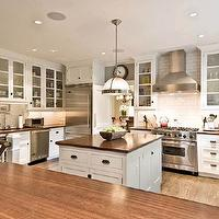 Stunning kitchen with white cabinets accented with oil-rubbed bronze hardware, ...