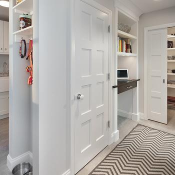 Anthony Wilder - laundry/mud rooms - mudroom, mudroom ideas, chevron rug, gray chevron rug, white and gray rug, built in desk, floating desk, mudroom office, mudroom desk, pocket door, storage closet, mud room dog area,