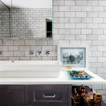 Lonny Magazine - bathrooms - ceiling height backsplash, white marble, white marble subway tiles, white marble subway backsplash, frameless medicine cabinet, long medicine cabinet, trough sink, bathroom trough sink, his and her faucets, wall mount faucets, wall mounted faucets, vanity shelf, black washstand, black bathroom vanity,