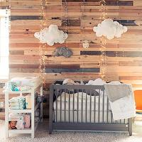 The Coveteur - nurseries - whimsical nursery, boy nursery, boys nursery, wood plank wall, plank wall, nursery wall, nursery accent wall, cloud pillow, gray crib, gray nursery crib, modern crib, modern nursery crib, changing table, crib bedding, white and gray crib bedding,