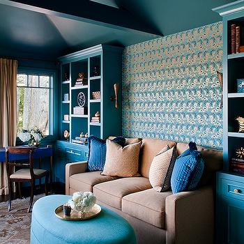 Kendall Wilkinson Design - living rooms - turquoise walls, turquoise wall color, turquoise built-ins, turquoise built-in bookcase, turquoise bookcase, turquoise bookshelves, camel sofa, camel colored sofa, contemporary camel colored sofa, teal pillows, turquoise ottoman, pleated turquoise ottoman, oval turquoise ottoman, gold tray, taupe and gray rug, taupe and gray patterned rug, desk below window, desk under window, vaulted ceilings, colored ceilings, teal ceilings, teal colored ceilings, beamed ceilings, ceiling beams, brass wall sconce, turquoise and gold wallpaper, turquoise and metallic gold wallpaper, desk chair, turquoise desk, oatmeal colored drapes, oatmeal colored curtains, floor length drapes, floor length curtains, hardwood floors, dark hardwood floors, turquoise living room, turquoise cabinets, turquoise blue cabinets, turquoise lacquer cabinets, turquoise lacquer built ins, lacquered cabinets, lacquered built ins, lacquered built in cabinets, turquoise blue cabinets, turquoise blue built ins, oval ottoman, turquoise oval ottoman,