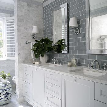 Heather Garrett Design - bathrooms - gray subway tile, gray subway tiled backsplash, mirror framed mirror, beveled mirror, beveled vanity mirror, polished nickel wall sconce, polished nickel wall sconce with white shade, white vanity, white sink vanity, white gray vanity, nickel hardware, marble counter, white footed vanity, gray bathroom vanity, marble hex tile, marble hex tiled floors, gray marble hex floor tile, hexagonal marble tiled floors, gray bathroom, monochromatic, monochromatic bathroom, marble countertop, garden stool, blue and white garden stool, nickel towel rail, nickel towel rod, crown molding, plantation shutters, white plantation shutters, interior shutter, bathroom shutters, marble subway tile, marble subway tiled wall, dual sinks, his and hers sinks, marble mosaic stripe, white and grey bathroom,