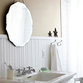 BHG - bathrooms - beadboard, bathroom beadboard, white beadboard, beadboard paneling, white beadboard paneling, cafe au lait walls, cafe au lait wall color, pedestal sink, beveled mirror, frameless mirror, chain hung beveled mirror, wall hooks, towel hooks, white towel, white shower curtain, subway tile, white subway tile, subway tiled shower surround, cottage bathroom, beadboard wainscoting, beadboard walls, beadboard backsplash, 3.4 beadboard, 3/4 wall beadboard,