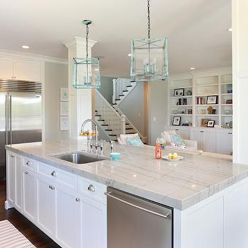 Charleston Home and Design - kitchens - white cabinets, white cabinetry, white kitchen cabinets, white kitchen cabinetry, hardwood floors, dark hardwood floors, nickel hardware, cup pull hardware, nickel cup pull hardware, kitchen island, kitchen island sink, kitchen island with sink, undermount sink, stainless steel sink, gooseneck faucet, stainless steel fridge, stainless steel refrigerator, crown molding, pot lights, recessed lighting, lantern pendant, turquoise lantern, turquoise lantern pendant, built-in fridge, built-in refrigerator, white quartzite countertops, white marble substitute, quartzite counters, quartzite countertops, marble substitute, stainless steel dishwasher, kitchen island dishwasher, open plan, open concept, built-in bookcase, built-in shelves, fireplace, fireplace built-ins, kitchen pillars, kitchen island pillars, quartzite, white quartzite, white quartzite countertops,