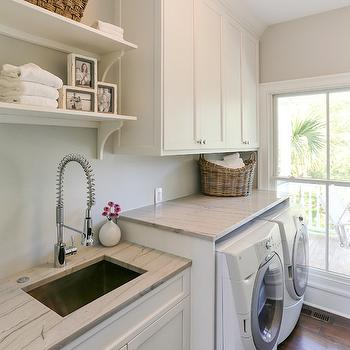 Charleston Home and Design - laundry/mud rooms - white cabinets, white cabinetry, white laundry cabinets, white laundry room cabinets, laundry room cabinets, laundry room cabinetry, nickel hardware, undermount sink, undermount stainless steel sink, modern spray faucet, spray faucet, laundry room sink, open shelves, white front load washer, white front load dryer, front load washer, front load dryer, rattan basket, hardwood floors, folding counter, white quartzite counters, white quartzite countertops, marble substitute, white marble substitute, quartzite, white quartzite, quartzite countertops, laundry room, laundry shelves, laundry room shelving,