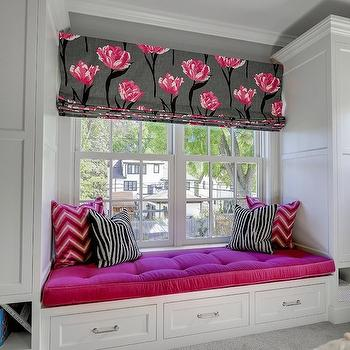 Great Neighborhood Homes - girl's rooms - window seat, built-in window seat, window seat storage, fuchsia pink pillow, fuchsia pink tufted seat cushion, pink window seat cushion, zebra print pillow, black and white zebra print pillow, pink chevron pillow, fuchsia pink chevron pillow, nickel hardware, sash window, double hung window, double hung sash window, black gray and pink floral window shade, black gray and pink floral window shade, carpet, wall to wall carpet, pink and gray bedroom, kids window seat, kids room window seat, pink and gray roman shade, modern floral roman shade,