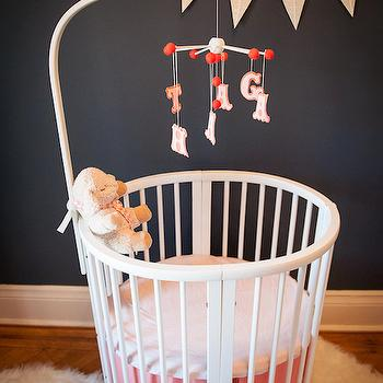 Brooklyn Limestone - nurseries - navy blue walls, navy blue paint, navy blue paint colors, navy paint, navy paint colors, oval crib, white crib, white oval crib, alphabet mobile, nursery mobile, crib mobile, pink crib bedding, nursery banner, 2 tone crib bedding, Stokke Sleepi Crib,