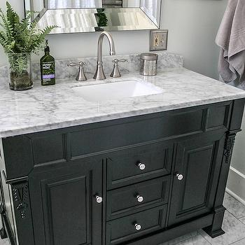 DIY Showoff - bathrooms - black vanity, black washstand, 48 inch vanity, 48 inch washstand, carrera marble, carrera marble top, bevel mirror, bevel vanity mirror, beveled mirror, carrera tiles, carrera tile floor, carrera marble floor, brushed nickel faucet, talia faucet, pale gray walls, pale gray bathroom walls, pale gray paint, pale gray paint colors, 48 inch black vanity, 48 inch black washstand,