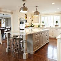 Lovely kitchen features Yoke Pendants with Large Shades over light gray kitchen ...