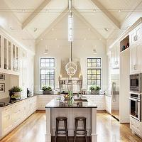 Amazing kitchen features Arteriors Laura Kirar Caviar Nickel Large Pendants over ...