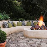 Jeff Andrews Design - decks/patios - stucco fire pit, built in fire pit, outdoor fire pit, round fire pit, fire pit with lava rocks, fire pit filled with lava rock, gravel patio, gravel patio with stepping stones, stucco bench, outdoor stucco bench, stucco outdoor seat, outdoor seating, terracotta pot, boxwood, green pillow, blue and white pillow, indigo blue pillow, outdoor entertaining, outdoor conversation area, firepit, outdoor firepit, outdoor bench, curved bench,
