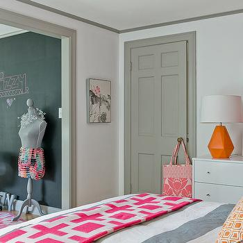 Ana Donohue Interiors - girl's rooms - white walls, white wall color, gray trim, gray door, gray molding, chalkboard, chalkboard accent wall, pink and white throw, pink and white geometric throw, gray and white striped duvet, striped duvet, orange and white pillow, orange and white geometric pillow, white dresser, orange lamp, modern orange lamp, contemporary orange lamp, white fretwork mirror, white geometric mirror, pink box, decorative pink box, gray door moldings, orange table lamp, jonathan adler lamp, chain link throw, gray door moldings, gray crown molding, Jonathan Adler Nixon Throw, Robert Abby Delta Pumpkin Lamp,