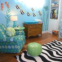 Wendy Bowman - nurseries - turquoise, turquoise walls, turquoise wall color, fish mural, under the water mural, under the water nursery, under the sea mural, under the sea nursery, hardwood floors, green side table, blue and green rocker, green pouf, green moroccan pouf, moroccan pouf, black and white rug, zebra print rug, vintage dresser,