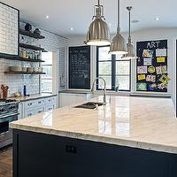 Gorgeous kitchen with subway tiled hood flanked by stacked floating wood shelving ...