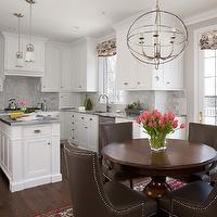 Amazing kitchen features white shaker cabinets paired with Super White Quartzite ...