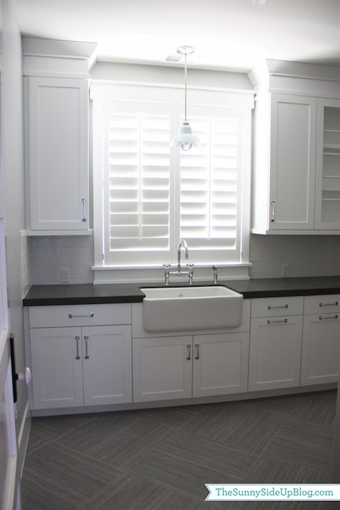 gray porcelain tiles transitional laundry room sunny