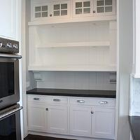 Sunny Side Up - kitchens - butler pantry, butlers pantry, butler pantry ideas, glass front cabinets, open shelving, butler pantry cabinets, butler pantry shelving, butler pantry cabinets, white shaker cabinets, shaker cabinets, black quartz, black quartz countertops, shelf corbels, vertical paneling, vertical backsplash,