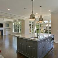 Stunning open concept kitchen with expansive gray kitchen island accented with ...