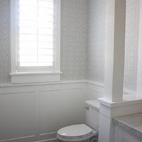Sunny Side Up - bathrooms - wainscoting, powder room, powder room wainscoting, wainscoting, white wainscoting, wainscoting powder room, white and grey powder room, geometric wallpaper, white and grey wallpaper, grey geometric wallpaper, wallpaper on top half of walls, wallpaper on upper walls, plantation shutters,