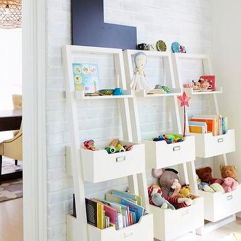 Land of Nod - girl's rooms: kids playroom, playroom ideas, white brick wall, kids bookcase, kids bookcases, kids bookshelf, kids bookshelves, leaning bookshelf, leaning bookcase, white leaning bookcase, white leaning bookshelf,