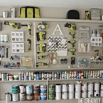The Creativity Exchange - garages - peg board wall, peg board garage wall, painted peg board, peg board organization, peg board storage, peg board storage wall, garage organization, garage storage, garage shelving, tool storage, tool organization, spray paint storage, wall hung tools, adjustable tool storage, garage peg boards, organized garage, chevron pin board, gray chevron memo board,