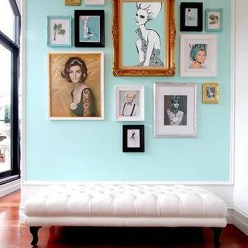 Megan Hess - dens/libraries/offices: turquoise office, turquoise blue office, white and turquoise office, fashion illustrations, fashion plate illustration, turquoise accent wall, turquoise blue accent wall, long bench, white tufted bench, baroque frame, gold baroque frame,