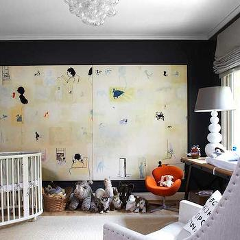 Lonny Magazine - nurseries - gray and black nursery, black walls, black nursery walls, white moldings, crown moldings, black walls white crown moldings, corner crib, corner nursery crib, oval crib, white oval crib, concentric throw, concentric throw blanket, black and gray throw, black and gray throw blanket, nursery art, console table, industrial console table, gray lamp shade, white lamp gray shade, gray glider, gray nursery glider, gray roman shade,